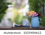 colorful roses in blue pot with ... | Shutterstock . vector #1025404612