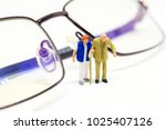 miniature old couple and... | Shutterstock . vector #1025407126