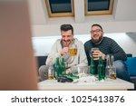 friends watching sport on tv at ... | Shutterstock . vector #1025413876