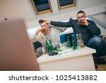 friends watching sport on tv at ... | Shutterstock . vector #1025413882