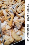 Small photo of oznei Haman, hamantashen, cookiesrecognizable for its triangular shape, associated with theJewishholiday ofPurim