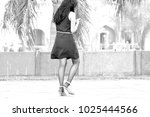 walking girl with mobile | Shutterstock . vector #1025444566