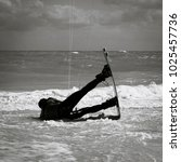 Small photo of Adrenalin fuelled extreme Adventure sport. Kitesurfing or Kiteboard Freestyle jump inthe air