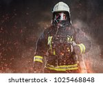 A Firefighter Dressed In A...