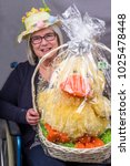 easter raffle disabled lady in... | Shutterstock . vector #1025478448