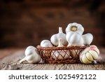 garlic. fresh garlic in wooden... | Shutterstock . vector #1025492122