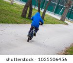 little boy riding a bicycle a... | Shutterstock . vector #1025506456