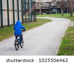 little boy riding a bicycle a... | Shutterstock . vector #1025506462