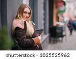 young blond girl with tablet...   Shutterstock . vector #1025525962