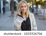 young woman walking talking on... | Shutterstock . vector #1025526706