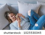 girl reading message in a smart ... | Shutterstock . vector #1025530345