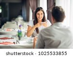 smiling woman on a date in a... | Shutterstock . vector #1025533855