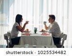 happy couple at restaurant... | Shutterstock . vector #1025534482