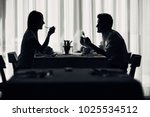 happy couple at restaurant... | Shutterstock . vector #1025534512
