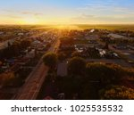 Small photo of Aerial view of sunset on a small town