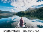 a girl sits in a canoe in a... | Shutterstock . vector #1025542765