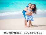 family fun on white sand.... | Shutterstock . vector #1025547688