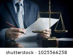 Stock photo lawyer or attorney works in his office scales on the desk 1025566258