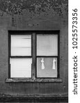 Small photo of ABSTRACT black and white image of a four pane window with on pane open and the curtains pulled