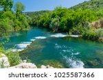 a fast mountain river flows...   Shutterstock . vector #1025587366
