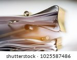 Small photo of Stack of Paper documents with clip, Pile of unfinished documents on office desk folders. Business papers for Annual Report files, Document is written,presented. Business offices concept.