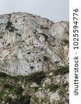 a white chalk cliff rock face... | Shutterstock . vector #1025594776