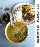 """Small photo of Malay street food called """"Meehun Soto"""" with the soy sauce gravy and delicious.chicken amd beef satay"""