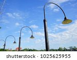 the row of curve streetlamps... | Shutterstock . vector #1025625955