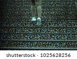 feet walking over the carpet... | Shutterstock . vector #1025628256