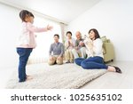 happy three generation family  | Shutterstock . vector #1025635102