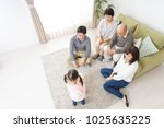 happy three generation family  | Shutterstock . vector #1025635225