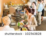 Stock photo cafeteria woman pay at cashier hold serving tray fresh food 102563828