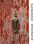 old fashioned door knocker on... | Shutterstock . vector #1025646376
