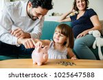 family saving money in piggy... | Shutterstock . vector #1025647588