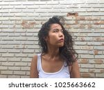 young asian woman in white vest ... | Shutterstock . vector #1025663662