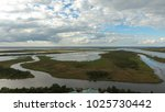 mobile bay scenery from above   Shutterstock . vector #1025730442