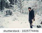 bearded man with axe in snowy...   Shutterstock . vector #1025774446