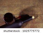 glass of wine a black bottle of ...   Shutterstock . vector #1025775772