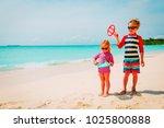 little boy and girl play beach... | Shutterstock . vector #1025800888