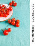 cheerry tomatoes on plate | Shutterstock . vector #1025817772