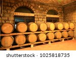 many barrels are placed in the... | Shutterstock . vector #1025818735