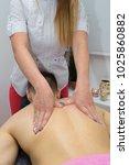 back massage. masseuse... | Shutterstock . vector #1025860882