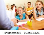 image of pupils raising arms... | Shutterstock . vector #102586328