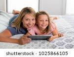 young blond caucasian mother... | Shutterstock . vector #1025866105