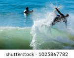 surfer in large wave wipes out... | Shutterstock . vector #1025867782