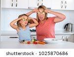 attractive woman cooking... | Shutterstock . vector #1025870686