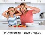 attractive woman cooking... | Shutterstock . vector #1025870692