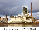 an old oil refinery at a canal... | Shutterstock . vector #1025874898