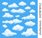 cartoon clouds isolated on blue ...