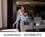 young couple relaxing at  home... | Shutterstock . vector #1025886295